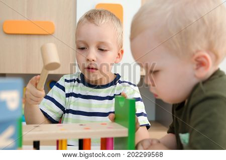 Kids Boys Playing With Toy Blocks At Home Or Kindergarten