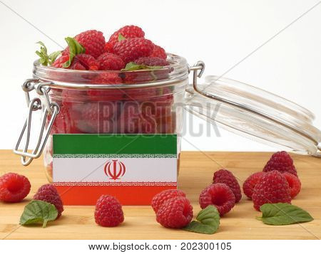 Iranian Flag On A Wooden Panel With Raspberries Isolated On A White Background