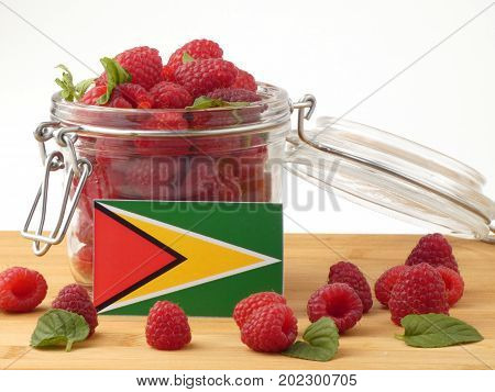 Guyana Flag On A Wooden Panel With Raspberries Isolated On A White Background