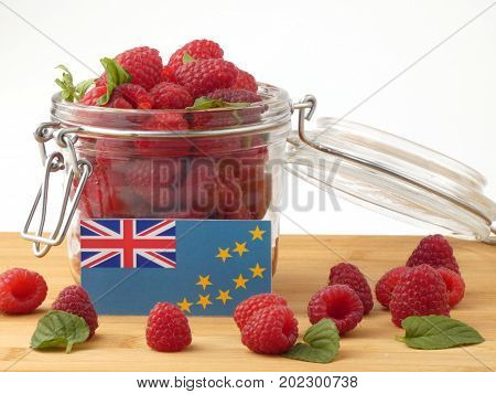 Tuvalu Flag On A Wooden Panel With Raspberries Isolated On A White Background