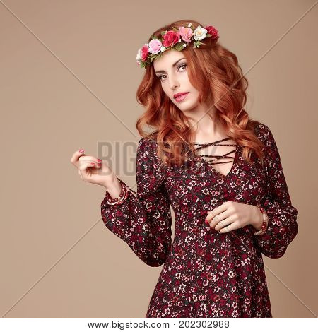 Autumn Fall Fashion. Redhead Model Woman in Stylish Floral Dress, Flower Hairband. Trendy Curly Hairstyle, Makeup. Fashion autumn Beauty Lady. Glamour Playful Boho Girl, Fashion Pose. Fall Concept