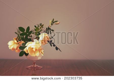 Sevral roses in the glass and a background for your text