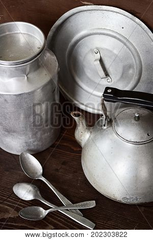 Vintage aluminum kitchen crockery are kettle milk can spoons