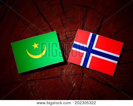 Mauritania Flag With Norwegian Flag On A Tree Stump Isolated