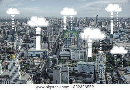 Abstract background top of view skyscraper with icon Cityscape background and Many buildings is connecting upload and download data information technology background about internet of thing.