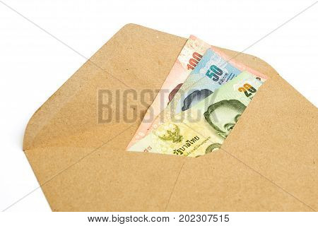 Thai Money Cash (Banknote) in brown Envelope isolated on white background