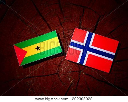 Sao Tome And Principe Flag With Norwegian Flag On A Tree Stump Isolated