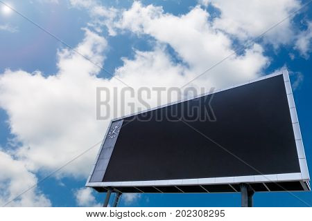 Blanks led scoreboard with copy space blue sky background.