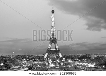 PARIS, FRANCE - OCTOBER 7: Illuminated  Eiffel tower on October 7, 2011. Sunset and the moon and the famous Paris landmark viewpoint