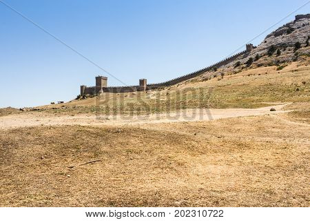 A serrated wall on a hill. Genoese ancient fortress near the city of Sudak.