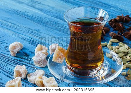 Middle East Black Tea With Thyme, Ethnic Glass And Glass Teapot, Vintage Wood Background