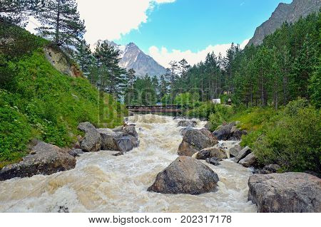 River and waterfall in forest, mountains of Caucasus, Russia.