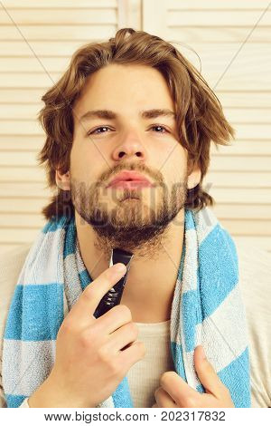 Bearded Guy With Striped Blue Towel On Light Texture Background