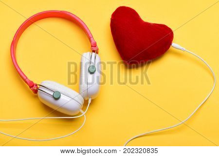 Headphones In White And Red Color With Soft Toy Heart