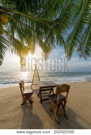 Sitting place and table in a tropical beach for romantic dinner