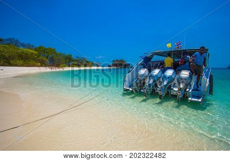 SATUN THAILAND March 13 2016 : Speedboat on beautiful island beach that have many tourists visiting at Tarutao national park and Koh Lipe in Satun. THAILAND