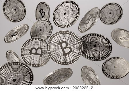 Close up of silver bitcoins tossed into the air as example for blockchain and crypto-currency concept