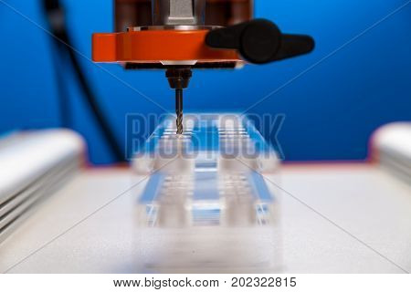 The milling machine processes the plastic blank