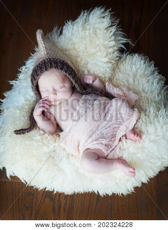 sleeping newborn girl baby in a basket