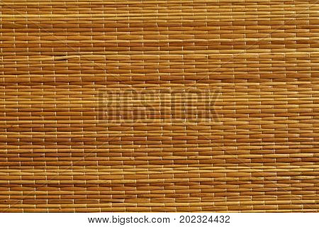 Orange Color Straw Mat Surface.