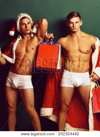 Handsome Macho Santa Twins