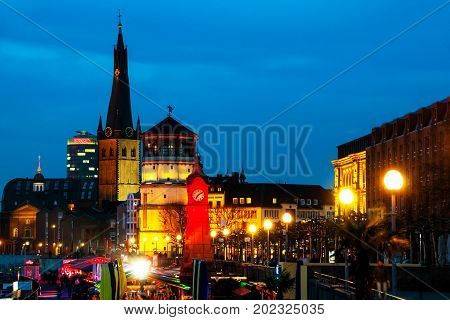 Dusseldorf, Germany. Illuminated old historical buildings in Dusseldorf, Germany at night with promenade area.