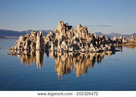 Tufa at Mono Lake California reflected in lake