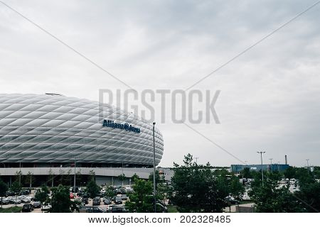 Munich, Germany - August 3, 2017: Exterior shot of Allianz Arena Stadium. Widely known for its exterior of inflated plastic panels, it is the first stadium in the world with a full colour changing exterior.
