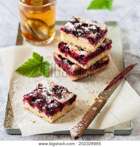 Black Currant Slice With A Glass Of Tea