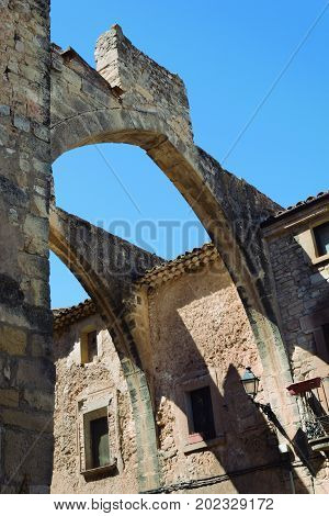 Ancient arches. Remains of the bridge that communicated long ago the two buildings.