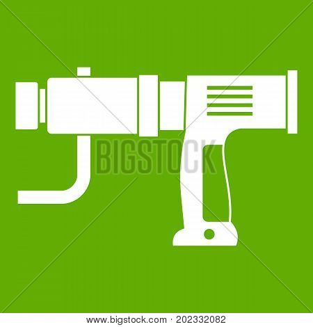 Hand drill icon white isolated on green background. Vector illustration