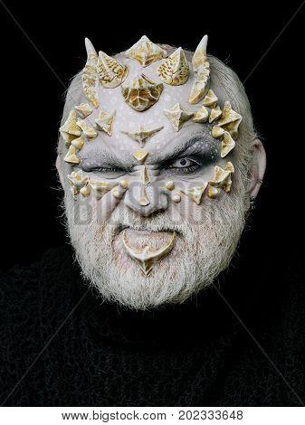 Man With Dragon Skin And Beard