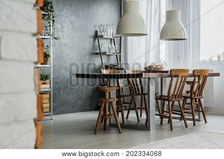 Communal Table And Industrial Lamps