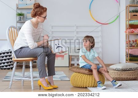 Boy Sitting With Counselor