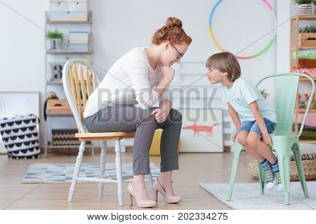 Boy With Counselor In Classroom