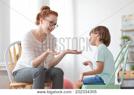Psychotherapist Talking With Autistic Boy