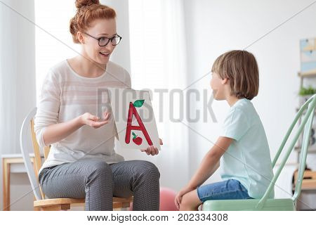 Friendly Speech Therapist And Boy