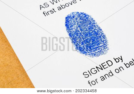 Getting thumb print for signature on business document.