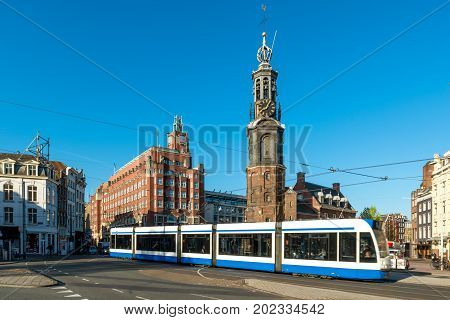 Amsterdam public transport in Netherlands - Trams at Dam square in Amsterdam the Netherlands. Amsterdam is capital city of Netherlands.