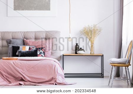 Modern Bedroom With Orange Chair