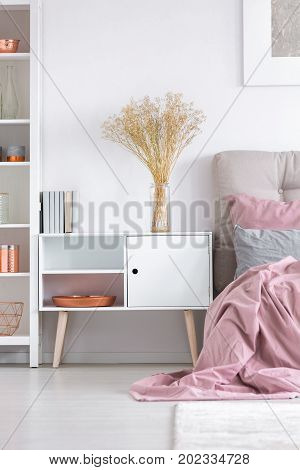 Cozy Bedroom With White Cupboard
