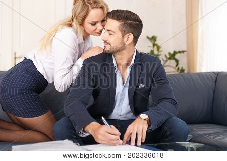 Young blonde secretary seducing rich businessman in office