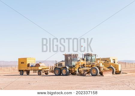 SPRINGBOKWASSER NAMIBIA - JUNE 28 2017: Road graders at the Springbokwasser gate of the Skeleton Coast National Park in Namibia