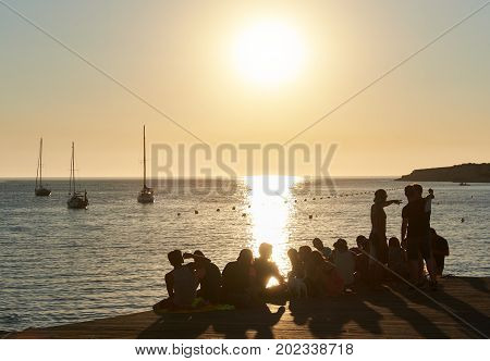 Ibiza Spain - June 11 2017: People during the sunset on the Calo des Moro in Ibiza. Balearic Islands. Spain