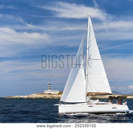 Ibiza Spain - June 10 2017: White sailboat Sun Odyssey 389 in the Mediterranean sea. Ibiza Balearic Islands Spain