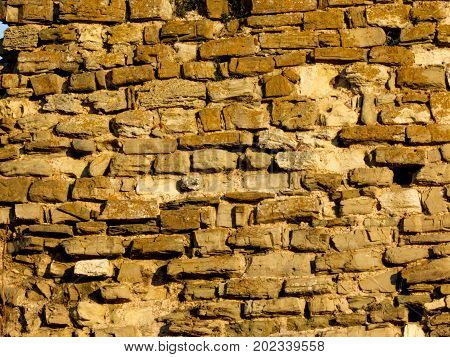 An old fortress wall aged, ancient, antique, archeology, architecture,