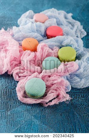 Classic French macaroon cookies on blue background