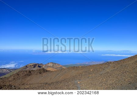 The of the Teide volcano on Tenerife the Canary Islands with Pico Viejo caldera and the view to the surrounding Atlantic Ocean and the clouds