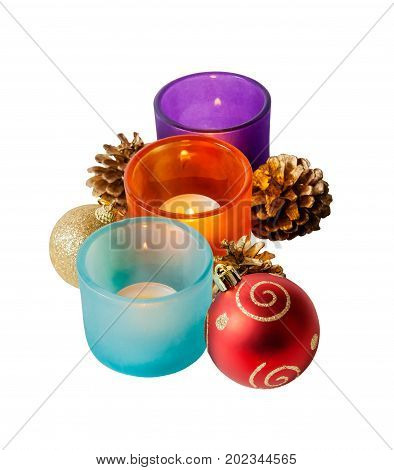 Christmas composition of balls and candles isolated on white background. Selective focus