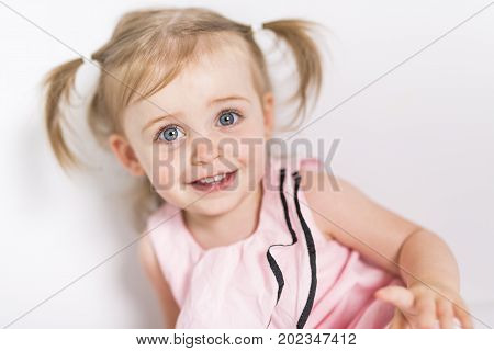 A Portrait of a 2 year old girl isolated on white background